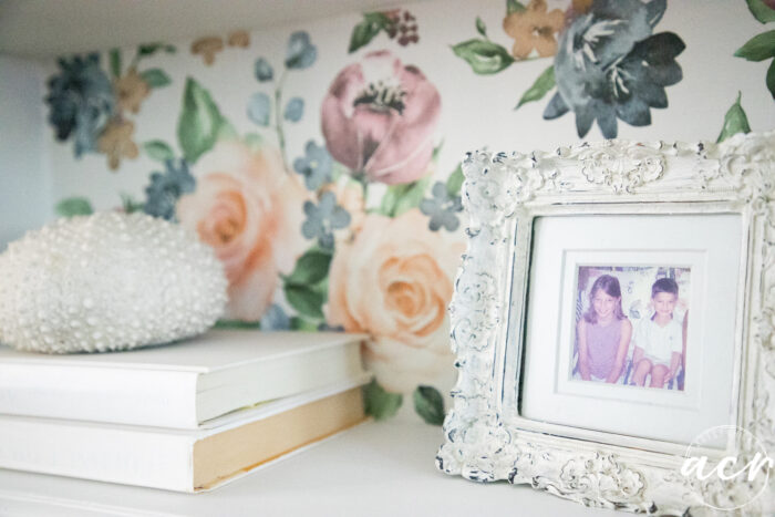 close up of white books and white framed photo