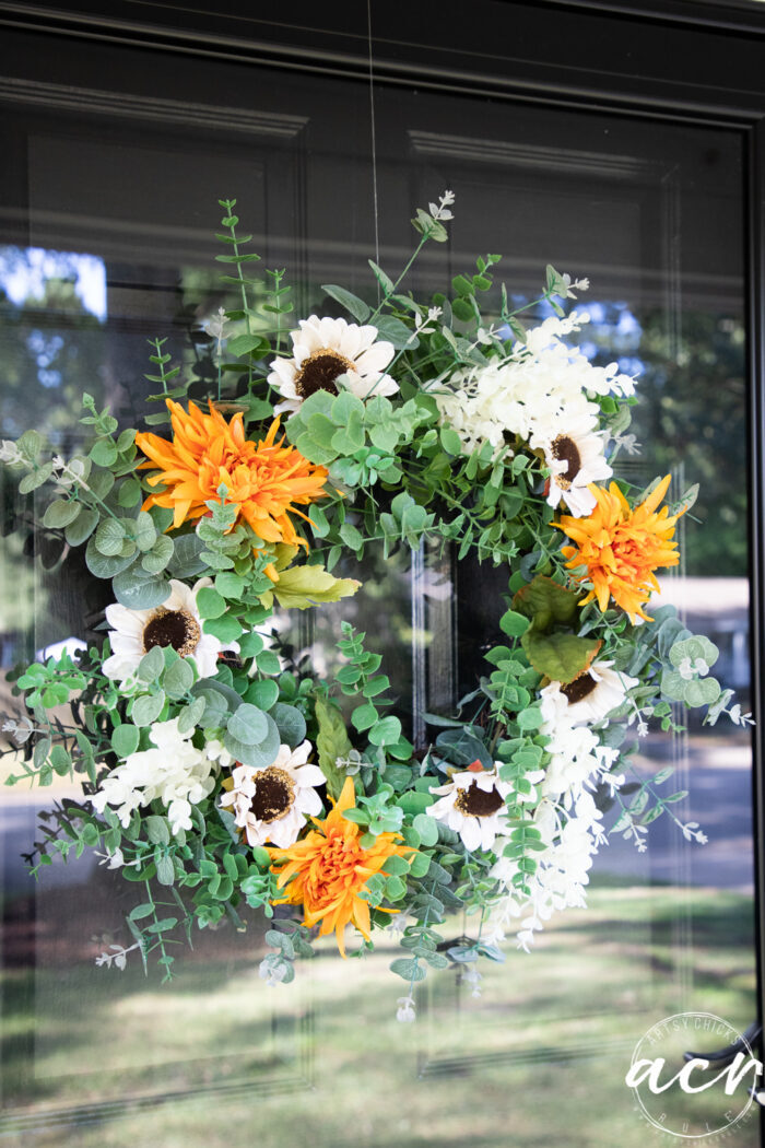 up close of green, white and orange fall wreath
