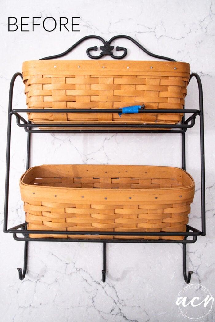 orange baskets and black iron holding them before