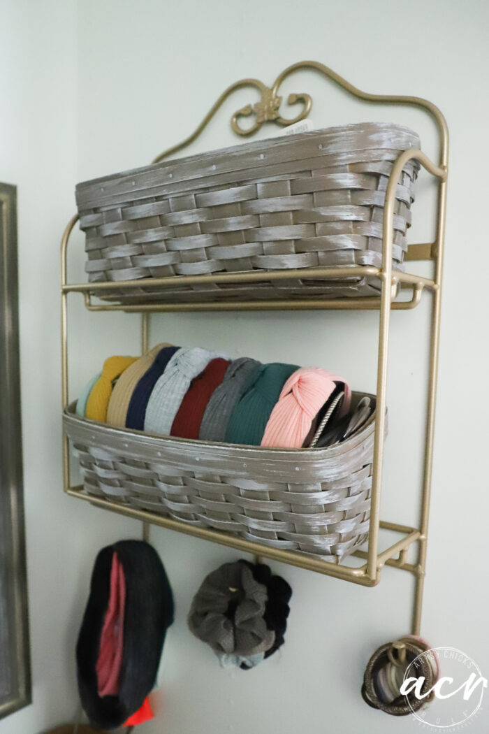 baskets on wall holding hair ties and more