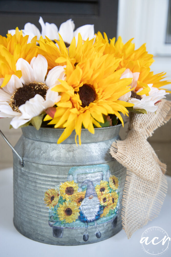 yellow and white sunflowers in metal tin with napkin decoupage gnome and truck