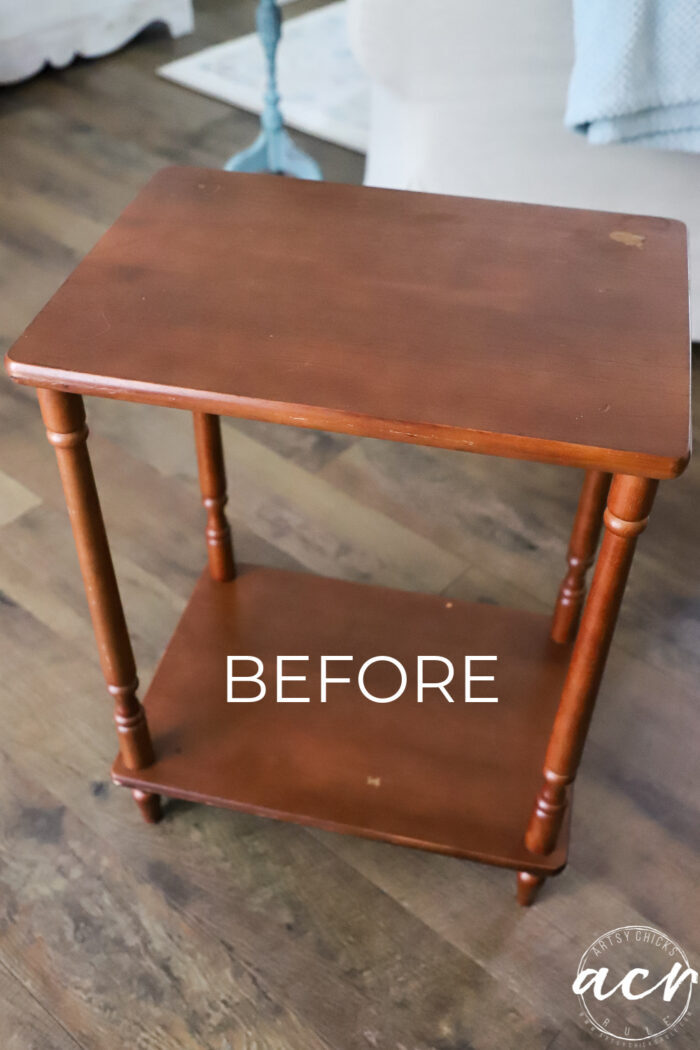orangey red stained 2 level table before