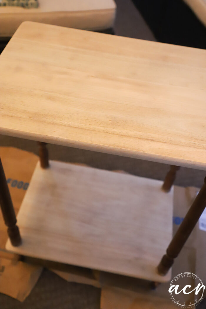both levels of table sanded to bare wood