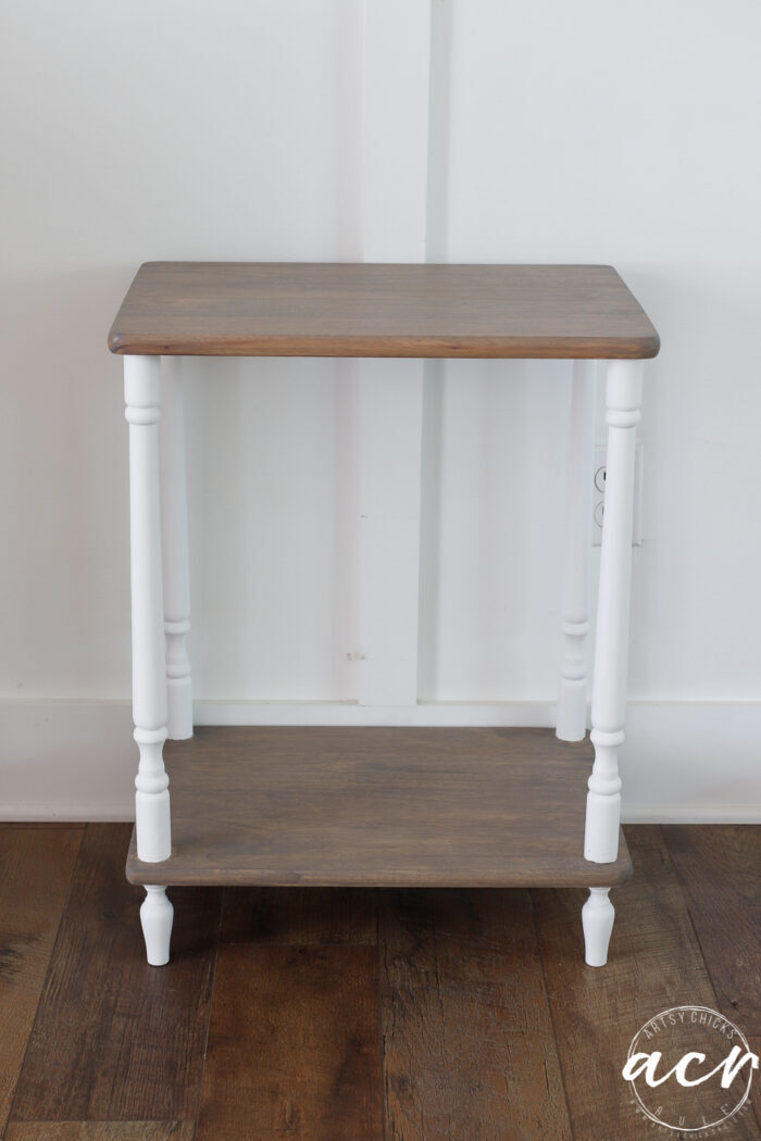 table finished against white wall, driftwood colored shelves and white legs