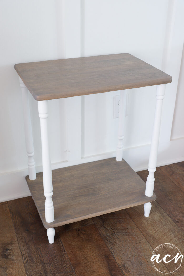 side view of driftwood stained table with white legs