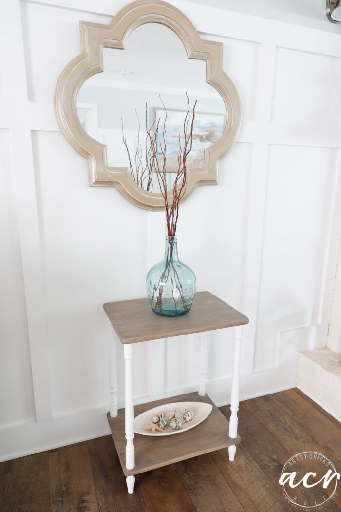 gold mirror with driftwood table and white legs