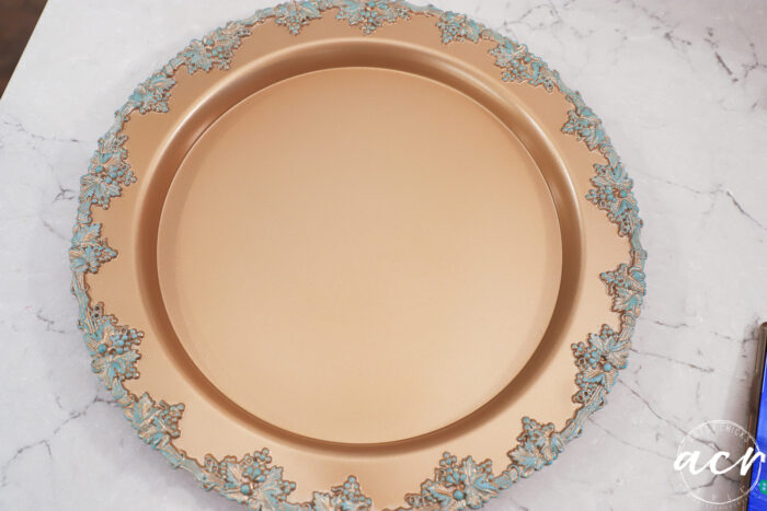 gold tray with patina edges on white counter